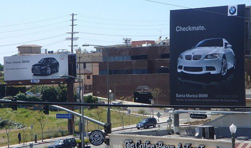 Audi on the left?....and BMW's answer on the right.  In Santa Monica.
